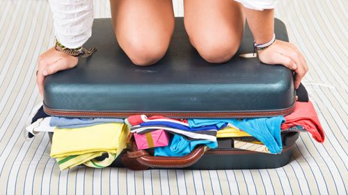 overstuffed-suitcase